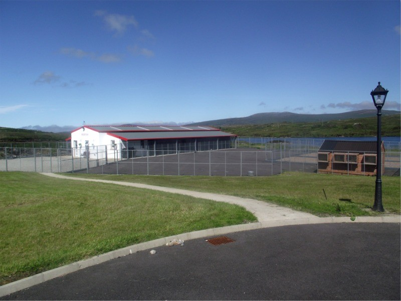 Lakeside Kennels & Cattery, Dungloe, County Donegal, Ireland - showing kennel and cattery building, exercise area and lake in background